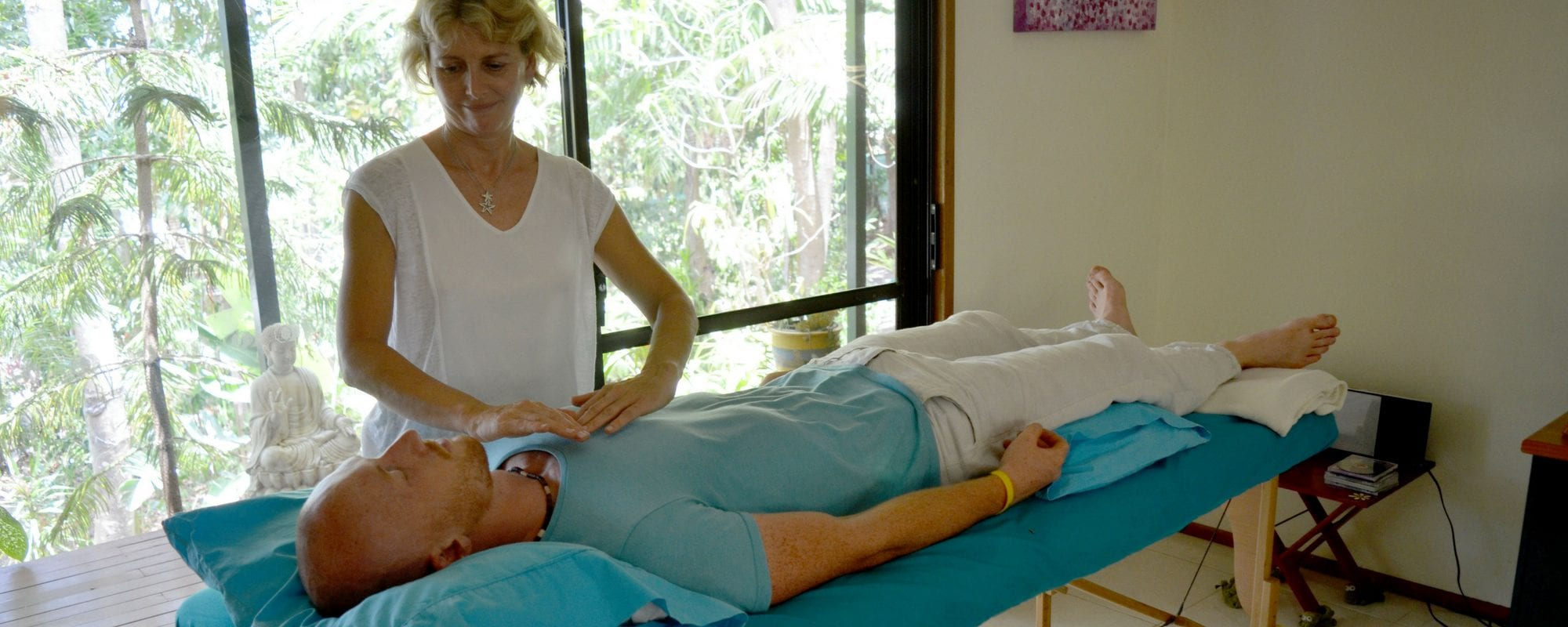 Julie Heskins from Rainfores Reiki in Cairns demonstrates reiki to a student